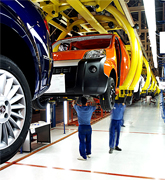 Manufacturing and assembly facilities of Fiat. The FIAT group's activities were initially focused on the industrial production of cars, industrial and agricultural vehicles. Over time it has diversified into many other fields, and the group now has activities in a wide range of sectors in industry and financial services. It is Italy's largest industrial concern. It also has significant worldwide operations, operating in 61 countries with 1,063 companies that employ over 223,000 people, 111,000 of whom are outside Italy