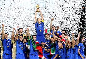 Italy's Fabio Cannavaro lifts the trophy after defeating France 5-3 in a shootout in the final of the soccer World Cup between Italy and France... CAMPIONI DEL MONDO, CAMPIONI DEL MONDO, CAMPIONI DEL MONDO, CAMPIONI DEL MONDO