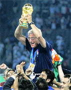 PRIDE AND JOY ... Italy coach Marcello Lippi and the Trophy... Italy coach Marcello Lippi said winning the World Cup was the greatest moment of his life after their nail-biting penalty shoot-out victory over France. Italy football soccer team on the Top of the World