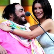 LAURA PAUSINI AND PAVAROTTI Luciano Pavarotti and his Friends, an organization created to help and support carity organizations around the world, a big concert every summer in Modena Italy with Brian May from Queen, Steve Wonder, George Michael, Zucchero, Laura Pausini, Lady Diana as special guest, The Spice girls, Andrea Bocelli, Bono from U2, Liza Minelli, and an incredible list of international guest coming to help childrens as Luciano's Friends